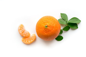 Ripe orange mandarin with green leaves and slices. Isolated fruit concept