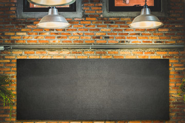 wood frame blackboard backgrounds , menu board with lamp and light on wall in restaurant