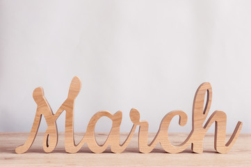 March - word carved out of wood. Spring time concept