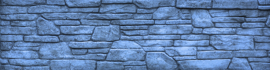 Blocks of hard blue stone, weathered, uneven wall background.The texture of solid stone,The texture of solid stone, interior home construction