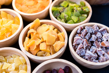 assorted dried fruit in wooden bowl
