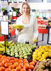 Female pensioner buying fresh fruits