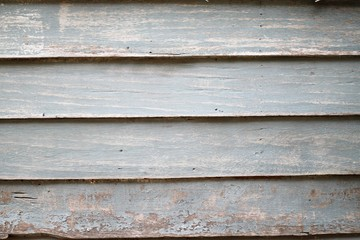Closeup background texture photo of rustic weathered barn wood with visible shades of grey, vintage style