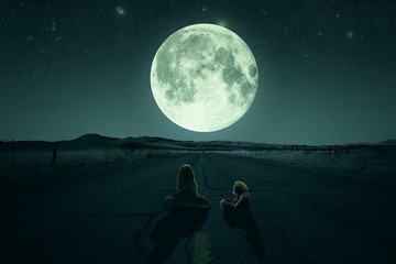 The girl with a teddy bear look at the moon. NASA.