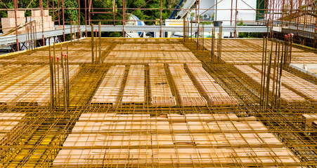 bricks and steel reinforcement before casting of concrete for the construction of a floor
