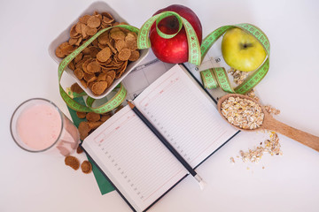 Healthy food with notepad for schedule