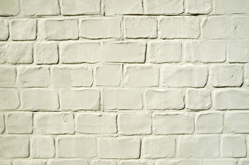 Decorative yellow stucco imitating brick wall