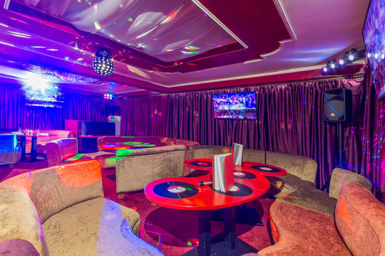 Karaoke room interior with colorful spot lights.