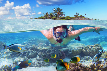 Young woman at snorkeling in the tropical water Wall mural