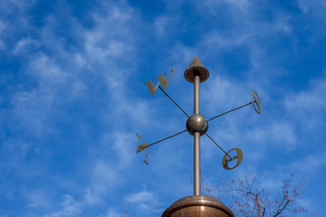 Compass with cardinal points against blue sky - 1 against blue sky - 1