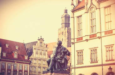 statue of the Polish poet, playwright and comedy writer Aleksander Fredro in the Market Square in front of the Town Hall of Wroclaw, Poland