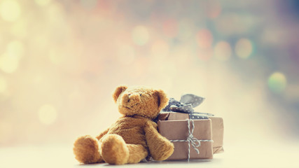 cute teddy bear and beautiful gifts on the fairy lights bokeh background