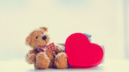 cute teddy bear, blue gift and beautiful heart shaped toy on the wondeful white background