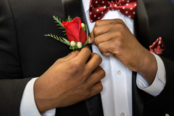 Pinning boutonniere to lapel