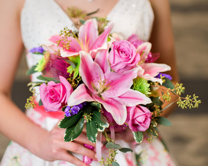 Teen girl holding pink rose and lily bouquet