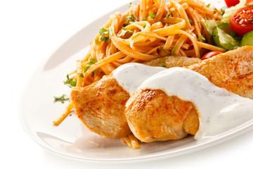 Fried chicken fillet, pasta and vegetables