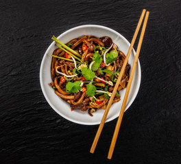 Asian noodles with spicy soy sauce and chicken