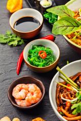 Asian food served on black stone