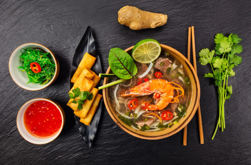 Asian soup pho bo with spring rolls