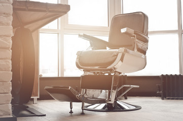 workplace of the hairdresser. stylish vintage barber chair in interior.