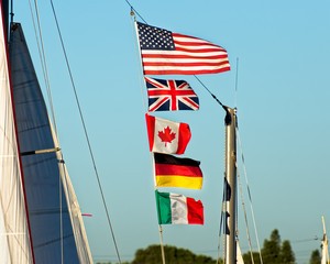 Flags waving on sailboat mast as it passes
