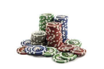 Tower of many colored poker gambling chips for hazardous game