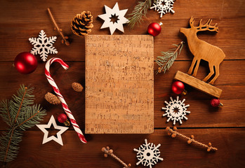 Notebook on wooden table with Christmas decorations