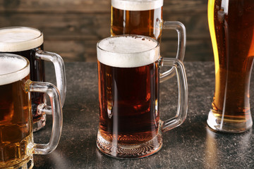 Glasses with beer on gray table
