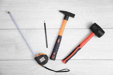Carpenter tools on laminated flooring