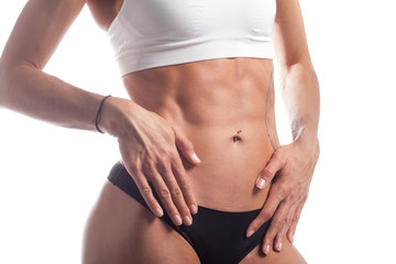 perfect female abs muscle isolated on white studio background