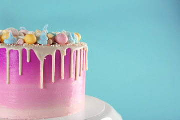 Beautiful Easter cake on color background