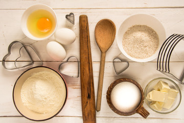 Baking ingredients for pastry on the wooden background