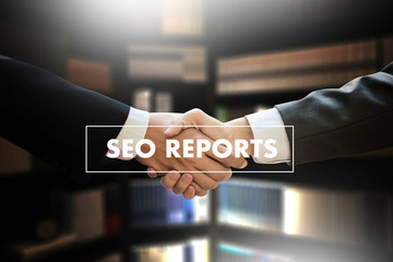 SEO REPORTS Concept Business team hands at work with financial reports and a laptop