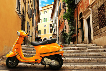 Scooter Orange vintage scooter on the background of Rome street