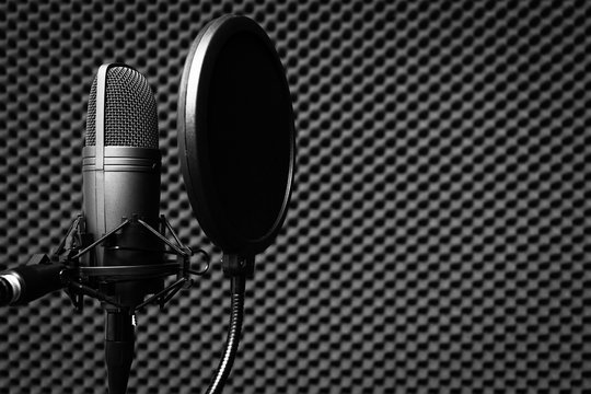 condenser microphone in recording studio for music background