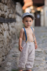 Little boy on the cobbled street