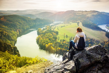 Girl looking at Vlatava river in Czech Republic
