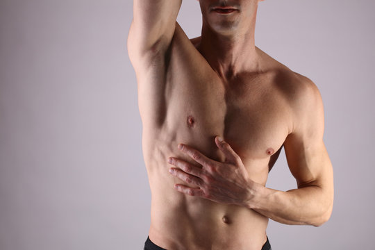 Close up of muscular male torso, chest and armpit hair removal. Male Waxing