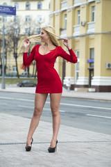 Bautiful blonde in sexy red dress