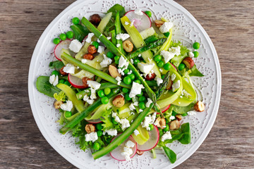 Fresh Green Asparagus salad witch Goat Cheese, peas, radishe, zucchini, lettuce and Hazelnuts.