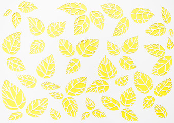 white, yellow background leaves. leaves cut from paper