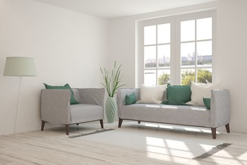White room with sofa and urban landscape in window. Scandinavian interior design