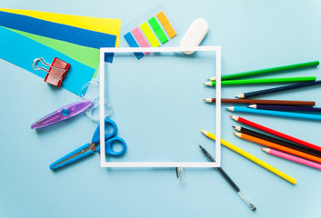 square frame with stationery flat lay on black chalkboard