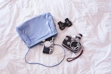 vintage bag, old camera and binoculars