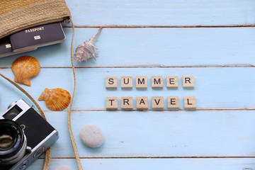 SUMMER TRAVEL text Old camera and passport in the holiday