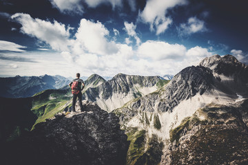 Mountain climber standing on a summit