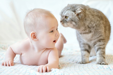 Cute smiling baby girl and cat