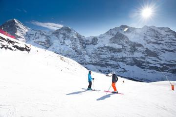 Jungfrau ski resort with famous Eiger, Monch and Jungfrau peaks in Swiss Alps, Switzerland