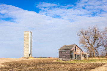 Dilapidated Farm House and Silo in the American Midwest