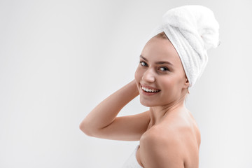 Carefree young woman relaxing after shower